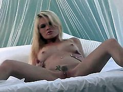 Alexis Ford with small boobs and smooth twat is completely naked and plays with her beaver non-stop