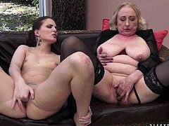 horny granny with big tits in stockings gets wild as her pussy is fingered and licked by her fellow young lesbian in a close up