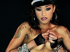 If you like a girl with a tough provocative attitude, dare to meet Skin Diamond, an ebony smokey babe, who's searching for hot thrills. The slutty bitch has several colorful tattoos and wears a beautiful makeup. See the exciting masturbation scene and enjoy the blowjob she offers to the horny guy!