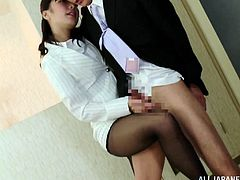 Amazing Asian cowgirl in a sexy nylon pantyhose thrilled as she gives a sensual handjob before bending over and having clothed sex doggystyle