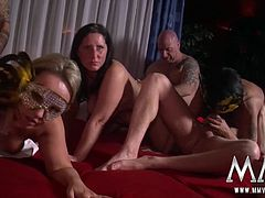 All the couples come together to suck fuck lick and cum.