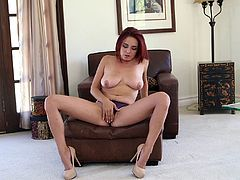 Cute redhead Ashley Graham demonstrates her blowjob skills