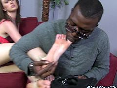 White slutty bitch Alana Rains performs steamy foot job to her black BF
