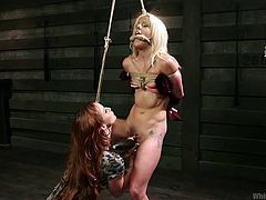 Skinny bitch Holly is all tied up and at complete disposal of her mistress, Bella. Bella knows how to please and torture the skinny whore so she started to tie her really hard and licked those small tits. After that she rubbed her pussy with a vibrator and gave it a few mean licks! What will she do next?