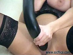 This brunette milf gets fisted in her pussy by her lover before he shoves a huge dildo in her loose cunt. Next, she takes over and fucks herself with that toy.