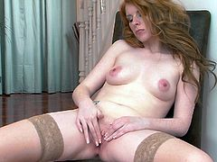 Hardcore solo video with redhead milf Nicole Hart wearing lingerie