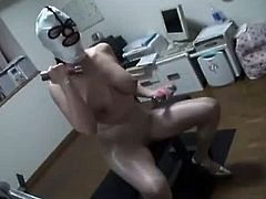 Hot japanese MILF is in the gym training and is wearing a mask and a sexy pantyhose. She gives her trainer a sloppy kiss, kinky footjob and a sloppy blowjob.