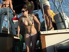 It's fun on a yacht where bikini girls get naked and flash