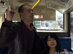 This sexy clerk is coming home from the office on the bus. A man is standing beside her and she accidentally, brushes her hand up against his crotch. Before long his dick is out of his pants hole and she is giving him a public handjob.