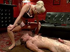A blonde bitch decided to punish a man. The submissive guy obeys to all her orders, following them without questioning. The guy licks Cherry's pussy, while she's sitting on his face. The slutty babe has covered his body with a net. See how badly this lady can humiliate a guy!