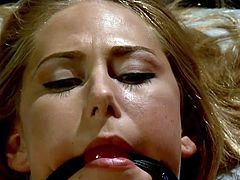 For this naughty blonde lesbian it's high time to be whipped. A merciless seductive milf whips her feet. See slutty Carter wearing a ball gag while her small nipples are pinched and horny pussy is fingered deep. There's no escape way from the bad tattooed mistress. Enjoy watching the kinky scenes!