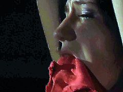 A babe has her red top cut off by her master while her hands were tied up above her head. He tortures her and then he fucks her fanny from behind. She misses the cumshot.