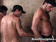 They just caught themselves a smooth ass. In the bathroom, they had him spread his legs for a frisk job. His smooth ass is groped as cocks starts probing the tight hole. They bang his sweet ass before turning to each other.