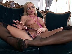 The lovely and gorgeous Sylvia Saint is looking really sexy, wearing her sheer black stockings. She teases you and rubs her nice long legs. The hot milf slides her hands down into her crotch and rubs her sexy cunt for you.