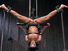 India is a nasty milf and she is confined in a bondage device, that has her upside down with a phallic object, being shoved into her wet cunt. Her eyes are covered, so she can't see, as the device is plunged into her vagina.