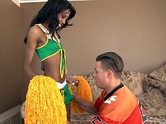 This lovely ebony cheerleader lifts up her skirt and lets her white jock boyfriend, have a nice taste of her yummy pussy. She moans loudly, as he gives her cunnilingus. Would you like to see this hot interracial couple fuck?