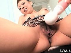 Juicy asian hairy pussy stimulated by vibrator till orgasm
