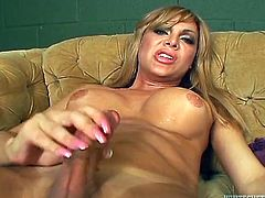 This hunk is on his knees and sucking on this hot tranny's cock. He gets her nice and hard and then, they jack off together. She beats her thick dick, while he watches and masturbates, too. The blonde transsexual is moaning, as she pleasures herself.