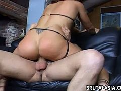 Alluring Asian bimbo wraps her lips around her lover's big thick cock and slobbers all over it. She rides on his erect wiener before being pounded rough.