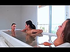 Three very beautiful  women having a very relaxing bath.