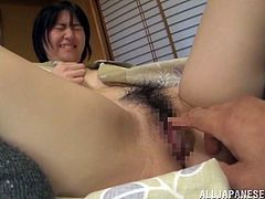 Erina Nagasawa is with her man in the bed and he has a camera to catch all the action that goes on. He fingers her pussy as she lays on the bed, making her nice and wet. He does it some more as she bends over, and she returns the favor by sucking his cock. She jerks his wang and uses her mouth expertly!
