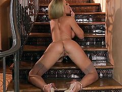 Randy Moore with huge melons and hairless bush is too horny to stop playing with herself