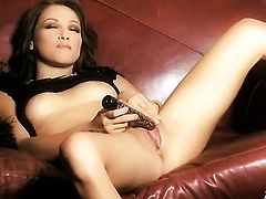 Celeste Star with tiny boobs and trimmed cunt has fire in her eyes as she plays with herself