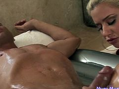 Full bosomed blond cougar presents solid deep throat in massage parlor