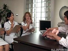 At this hospital in Hakodate the best way to make a patient feel better, is go give him a handjob. So, one of the doctors on staff is showing the sexy nurses, how to tug on cocks, by demonstrating on a big dildo. Watch, as they follow her lead. Pantyhose adds an extra sensation.