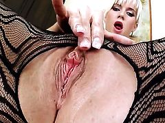 Cindy Dollar with giant knockers and trimmed snatch screams as she plays with herself