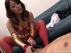 Sexy and weird slut Nao loves to tease and dominate her man. She rubs the spike of her high heels on his crotch and rubs his nipples, to get him nice and turned on. Look at how firmly she grabs his cock and jacks him off.