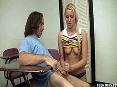 Vanessa Cage is a young, sexy cheerleader who has some time on her hands to spare. She occupies it with stroking a guy's cock using lube that she had with her.