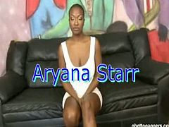 Ghetto Gaggers Aryanna Starr is truly a star of butt sex. Her curly hair is tied in a bun. No other jewelry is found on her body except for the gold stud earrings and a ring. The white guy is leaning over on the side of the couch. His hand is resting on Aryanna Starr's waist. The guy is still wearing rubber shoes with black socks. The black girl's boobs are resting on the couch. One hand is support her body. Her elbow is also acting as a support. Aryanna Starr is bending over on a huge black leather couch.