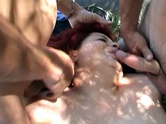 Two huge boners taking sizzling hot red head fat mama down for threeway outdoor pussy pounding adventure.