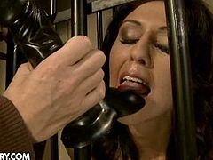 Mandy the dominatrix has a new challenge - how to corrupt sweet Claudia. But she's a master of her art and pretty soon, down in Mandy's dungeon, she has Claudia tied up behind bars and screaming in pain. But the mistress will only go so far, because she knows how the pleasure will come and she'd like to see this Claudia back at her dungeon soon.