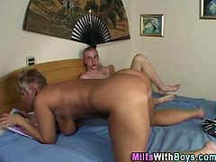Moms With Boys brings you a hell of a free porn video where you can see how this mature blonde slut gets banged by a horny young stud while assuming very naughty positions.
