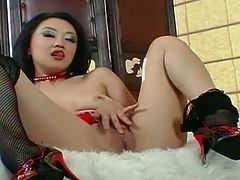 Lingerie Videos brings you a hell of a free porn video where you can see how this naughty Asian belle masturbates in a red corset and poses while assuming sexy positions.