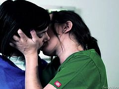 Take a look at these two dark haired cuties. They both need a break from their long shifts, and these hot nurses kiss each other passionately. The girls take their costumes off and play with each other's amazing natural boobs, on the examination table. Sinn moans, as her pussy is eaten out.