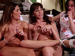 There are so many sexy lesbians in this video you won't know, where to begin. The girls are chatting nude together, but things get hot and horny very quickly. The girls play with their boobs and rub each other's pussies.