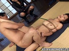 Pretty Asian woman is captured and used as a sex slave. Her petite body can't hold out much longer as her captor is making her suck his dick before finally stick it into her hairy pussy. He ends the session with a big creampie.