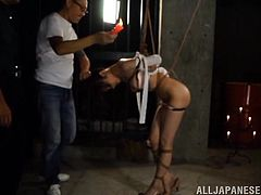 Erina is tied up tightly with rope and locked in the sex dungeon by her master. The master pours hot wax all over he sexy body. The wax drips all over her back and even on her yummy ass. Se loves the mix of pain and pleasure.