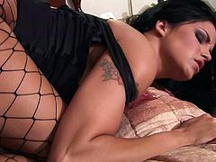 Tattooed porn star with long dark hair enjoying a hardcore fuck on her bed