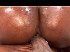 Sexy black babe gets her bubble ass oiled and fucked hard.