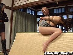 A hot mistress and a sadistic master bound a girl and use her. They have fun by shoving toys and food inside her hairy cunt and also by bounding her and whipping her.