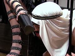 Blonde Arab mistress for horny slave. This busty whore wearing sexy lingerie uses a dildo to fuck her man's hairy ass. He gets down on all four and lets her peg him with a strapon.