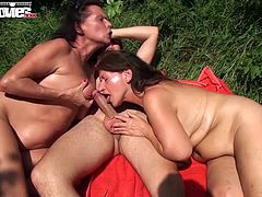 Two horny grannies make a random guy cum before taking advantage of a young girl and fucking her with a strap-on