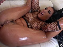 She wore fishnet and got all oiled up, just to entice him, and it worked! He not only rubbed his body against her boobs, but opened up her holes too. And it wasn't long before he entered her tight pussy and pounded her, like crazy. And it looks, like she likes it, because she sucks his cock in return.