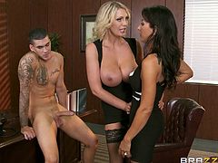 This lucky guy gets to have his cock sucked by two lovely milfs. He licks both of their nipples and then they tag team his cock. The blonde makes the man stick his face in between the other milf's legs and eat her out.