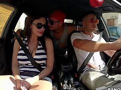 Big boobed brunette Aletta Ocean in black and white striped dress gets her pussy rubbed by curious guy during the ride. She gives great car blowjob with another guy in the backseat.