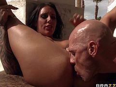 Raven haired tattooed brunette Austin Lynn give deep blowjob and gets her neatly trimmed pierced pussy eaten out by passionate Johnny Sins beside the pool They are horny as hell in this hot scene.